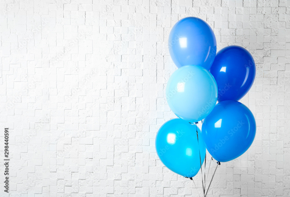 Fototapety, obrazy: Bunch of blue balloons near white wall, space for text. Greeting card