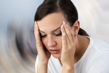 Woman Suffering From Headache ...