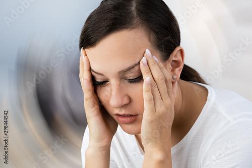 Fotografía  Woman Suffering From Headache Dizziness
