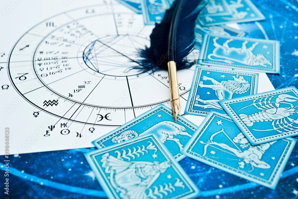 Fototapety, obrazy: quill pen in form ob blue feather lying on horoscope and zodiac signs like astrology concept