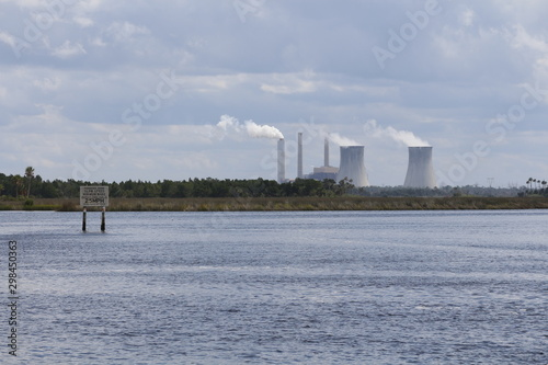 Cuadros en Lienzo Power plant cooling towers viewed over Florida wetlands
