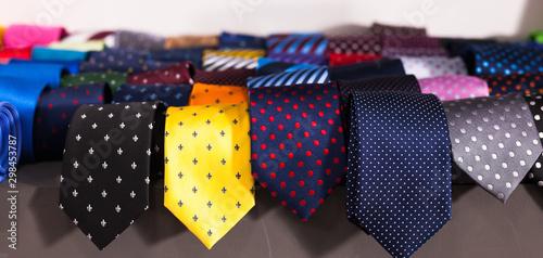 Carta da parati  row of Neckties on hangers in men clothing store
