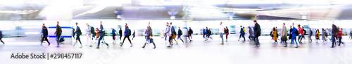 Fotografie, Obraz Lots of business people walking through big open space