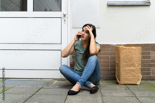 Young Woman Waiting In Front Of Closed Door Fototapete