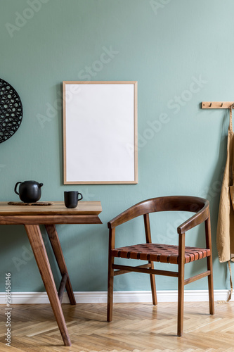 Fotografiet Stylish scandinavian dining room interior with mock up poster frame, wooden table, furniture, teapot with cups, black decoration and elegant accessories