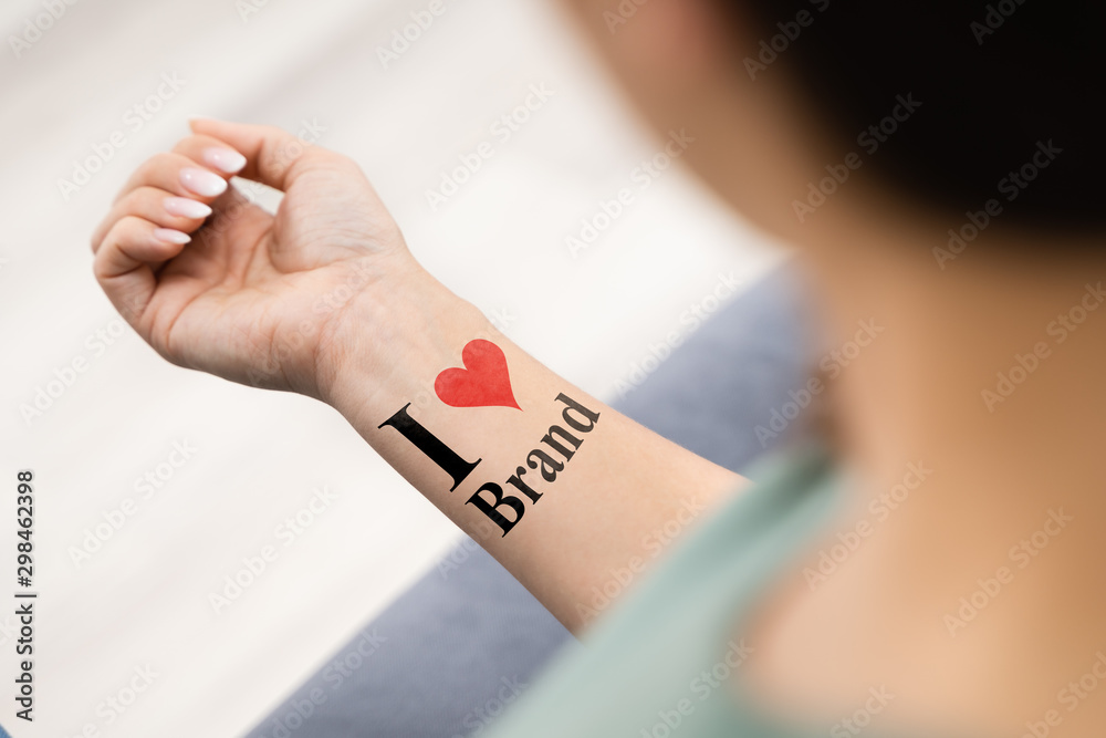 Fototapeta Woman Showing I Love Brand Tattoo