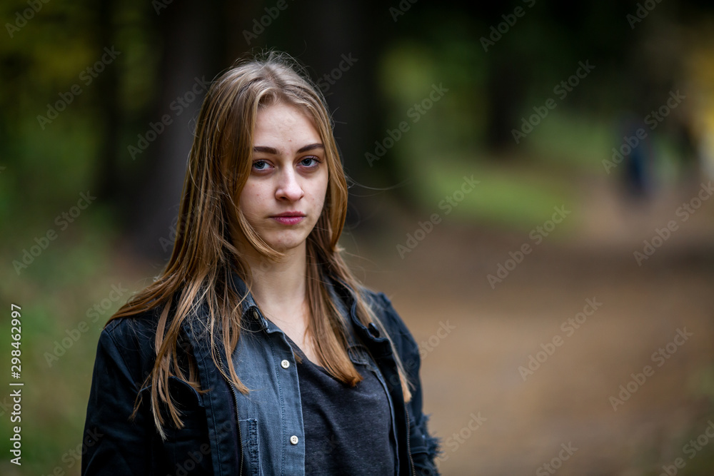 Fototapety, obrazy: Teenager. Young beautiful white caucasian addict teenage girl with unwashed hair and bruises under the eyes in a dark forest in the autumn evening.