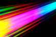 canvas print picture Colourfull burst of prismatic light creating lines of blured motion against a black background
