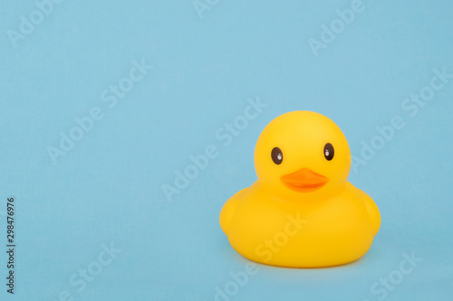 Obraz na plátně  bath yellow rubber duck on blue background