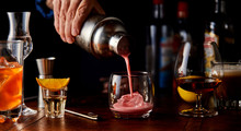 Bartender Pouring A Fruity Coc...