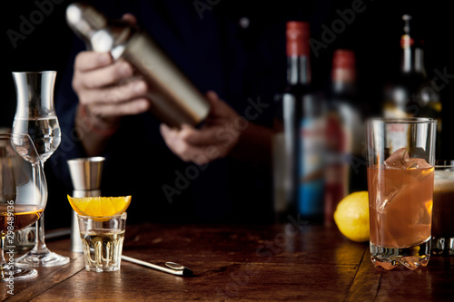Barman mixing cocktails in a martini shaker Canvas Print