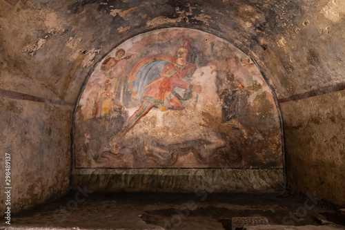Fresco Representing the Mithras divinity was killing a white bull, inside of the Mithraeum of Ancient Capua Canvas Print