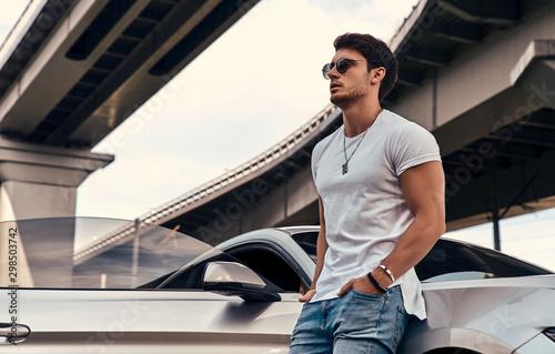 Fototapeta Handsome man near car obraz