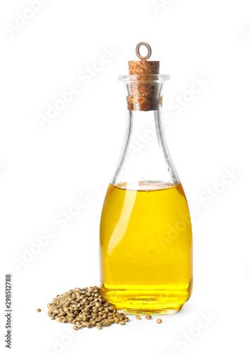 Fototapeta Bottle with hemp oil and seeds on white background obraz
