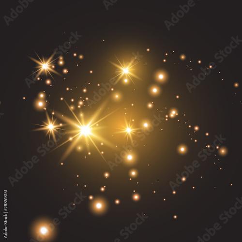 Fotografía  golden fire on a transparent background, golden dusty stars