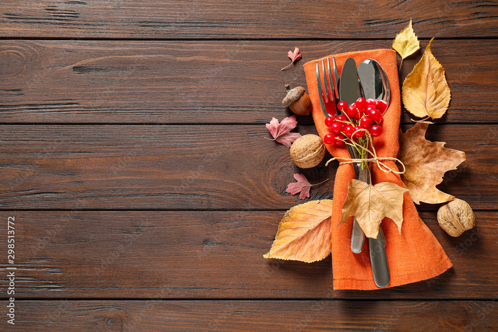 Fototapety, obrazy: Cutlery and autumn decorations on wooden background, flat lay with space for text. Happy Thanksgiving day