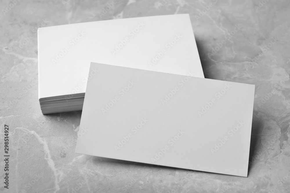 Fototapety, obrazy: Stack of empty sheets on grey marble table. Mock up for design