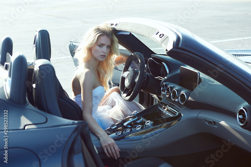 Fashion portrait of dreamy woman in the luxury car. No retouch. - 298523332