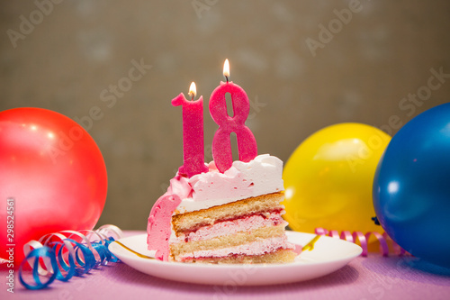 Happy eighteenth birthday cake and pink number eighteen candles with balloons an Poster Mural XXL