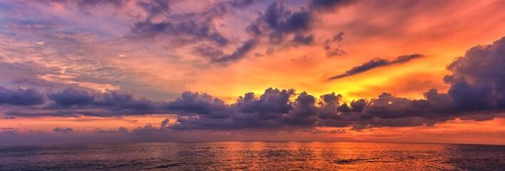 Phuket beach sunset, colorful cloudy twilight sky reflecting on the sand gazi...
