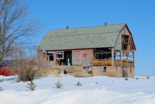 Terrific Old Decaying And Falling Apart Faded Red Barn In A Winter's Snow.  So Picturesque And What Stories It Could Tell.