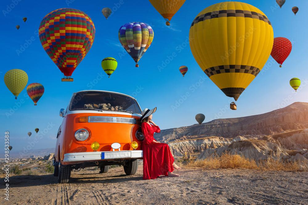 Fototapety, obrazy: Beautiful girl looking at hot air balloons in Cappadocia, Turkey.
