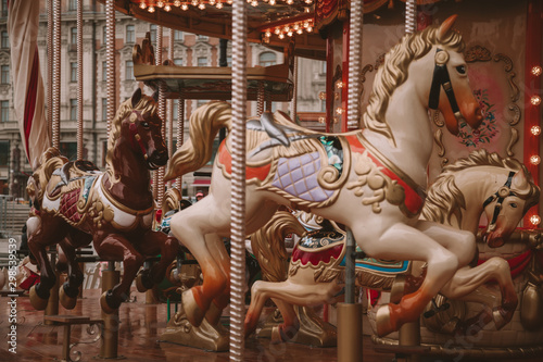 Papiers peints Attraction parc Old carousel with horses in a holiday autumn evening park with nobody