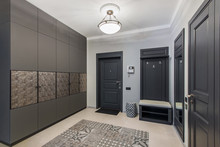 Interior Of Hallway In A Modern Apartment With A Stylish Wardrobe And A Beautiful Tiled Floor