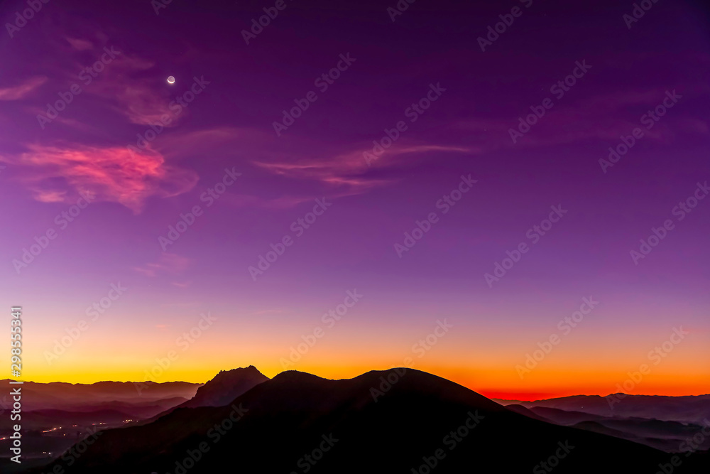 Fototapety, obrazy: Silhouetted Mountain Peaks at Magenta Sunrise