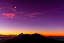 Silhouetted Mountain Peaks At ...