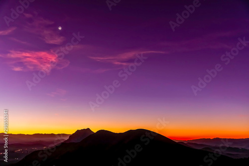 Silhouetted Mountain Peaks at Magenta Sunrise