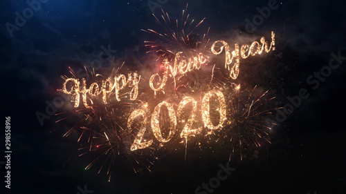 Fototapeta 2020 Happy New Year greeting text with particles and sparks on black night sky with colored fireworks on background, beautiful typography magic design. obraz