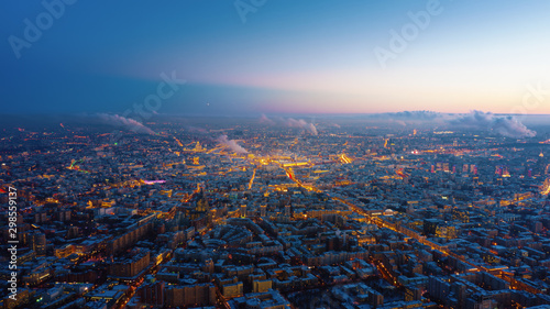 Beautiful aerial view to Moscow city on the sunset. Picturesque motion of the evening metropolis with street and building lights gradually turning on and colorful sky on the background. - 298559137