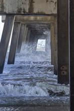 Crashing Waves Under Pier