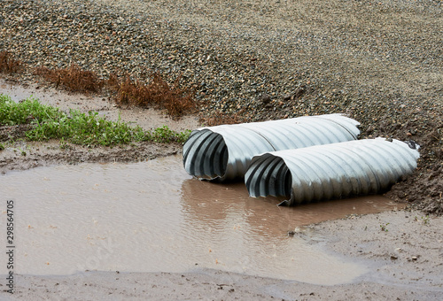 Fotografia, Obraz  Drainage Culvert Pipe In The Rain Water