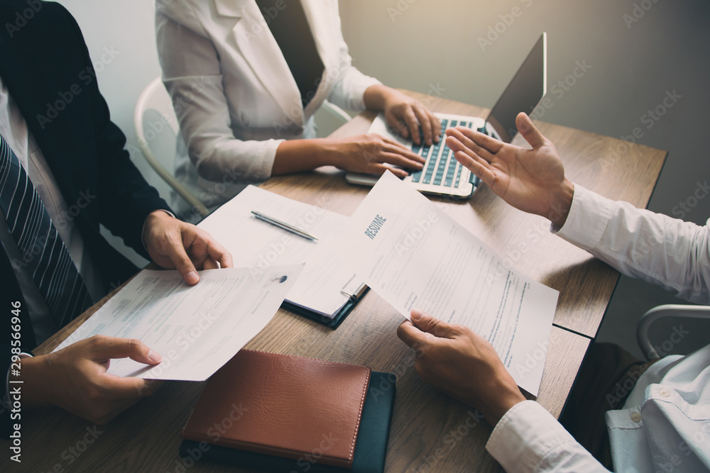 Fototapeta Serious asian businessman important conversation with male employee are reviewing resume documents.