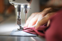 Hand Of The Seamstress Is Usin...