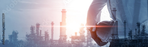 Future factory plant and energy industry concept in creative graphic design. Oil, gas and petrochemical refinery factory with double exposure arts showing next generation of power and energy business.
