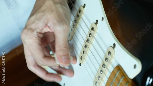 Obraz na plátne  playing electric guitar with pick
