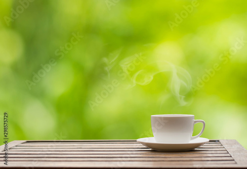 Fototapeta  Coffee espresso on wood table nature background in garden,warm tone
