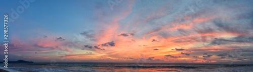 Fototapeta Phuket beach sunset, colorful cloudy twilight sky reflecting on the sand gazing at the Indian Ocean, Thailand, Asia. obraz