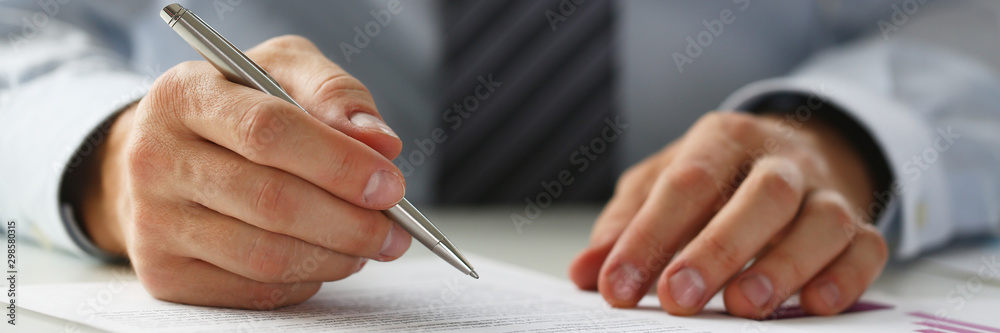 Fototapety, obrazy: Hand of businessman in suit filling and signing with