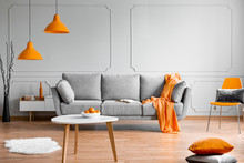 Orange Lamp Above Grey Scandin...