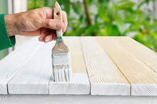 Worker Painting White Wooden Furniture Outdoor.