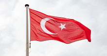 Turkish Flag Waving Against Cloudy Sky Background