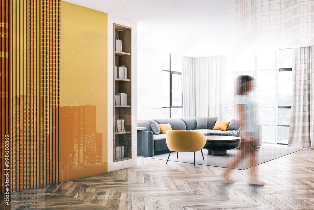 Fototapety, obrazy: Woman walking in white and yellow living room