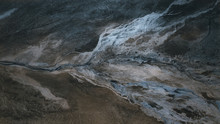 Abstract Forms Of Ice On Land From Drone