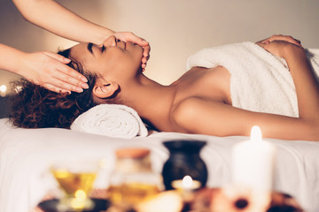 Relaxed lady enjoying aroma therapy in spa salon