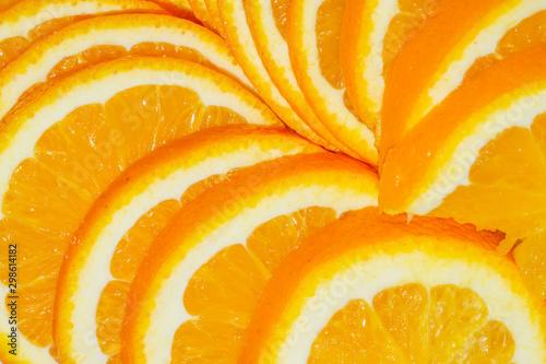 Fotografie, Obraz  Sliced orange. yellow fruit close up background
