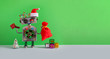 canvas print picture - Santa Claus steampunk robotic toy with gifts bag on green background. Festive Christmas New year greeting card mockup with funny robot dressed red Santa hat. empty space backdrop for text